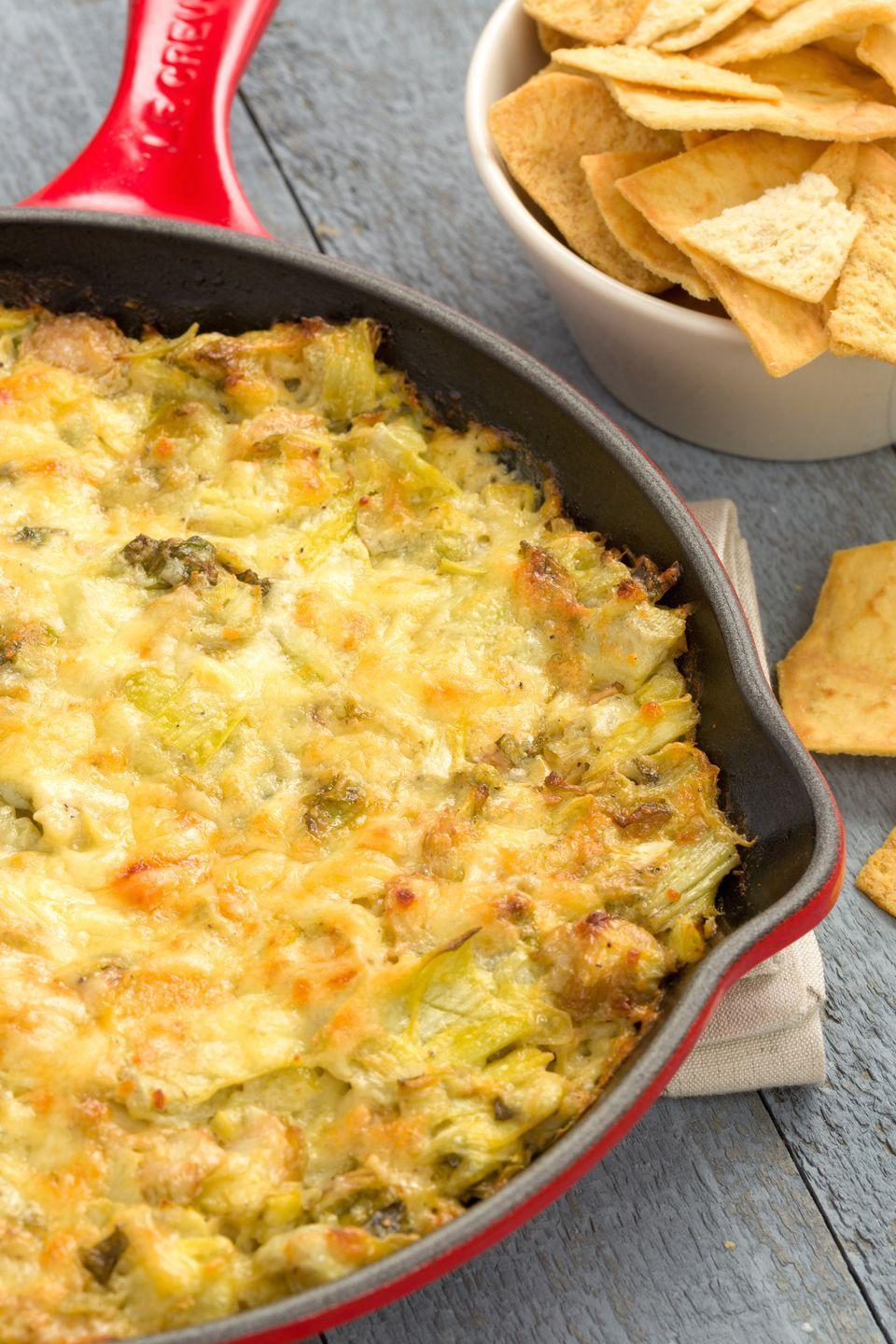 """<p>Replace spinach with brussels sprouts and you've taken your basic dip to the next level.</p><p>Get the recipe from <a href=""""https://www.redbookmag.com/holiday-recipes/thanksgiving/recipes/a44805/cheesy-brussels-sprout-artichoke-dip-recipe/"""" rel=""""nofollow noopener"""" target=""""_blank"""" data-ylk=""""slk:Delish"""" class=""""link rapid-noclick-resp"""">Delish</a>.</p>"""