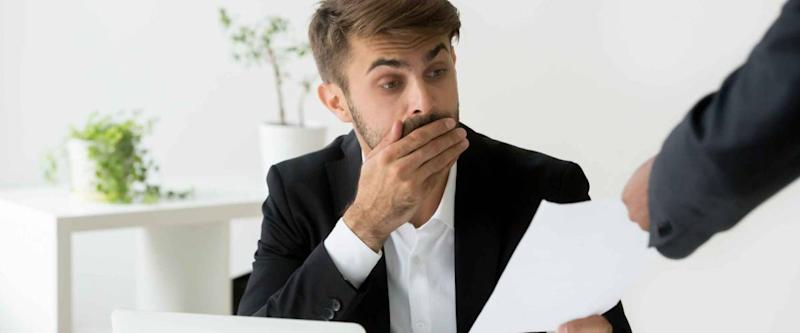 Surprised person receives scary document