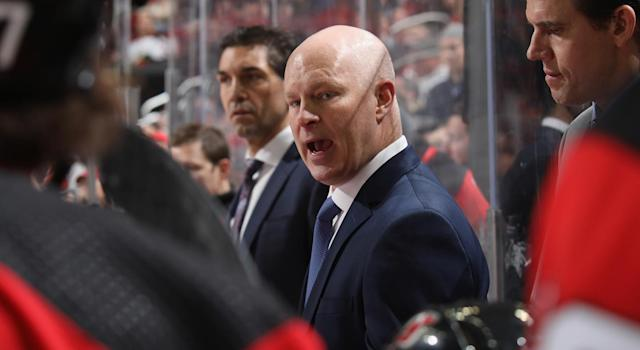 NEWARK, NEW JERSEY - JANUARY 19: John Hynes of the New Jersey Devils handles bench duties against the Anaheim Ducks at the Prudential Center on January 19, 2019 in Newark, New Jersey. The Ducks defeated the Devils 3-2. (Photo by Bruce Bennett/Getty Images)