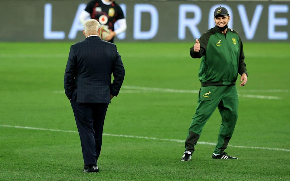 Rassie Erasmus, (R) the South Africa Springbok head coach,signals to the Lions head coach, Warren Gatland prior to the match between South Africa A and the British & Irish Lions at Cape Town Stadium on July 14, 2021 in Cape Town, South Africa. - GETTY IMAGES