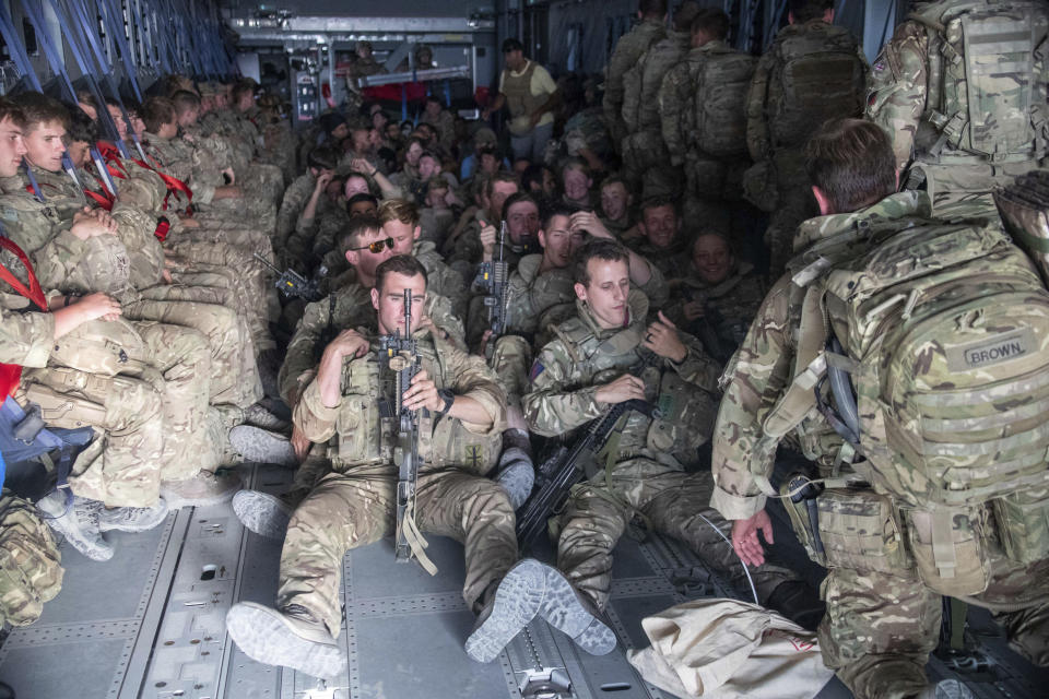 """Photo issued on Saturday Aug. 28, 2021 by Britain's Ministry of Defence (MoD) showing UK military personnel onboard a A400M aircraft departing Kabul, Afghanistan. Britain ended its evacuation flights Saturday, though Prime Minister Boris Johnson promised to """"shift heaven and earth"""" to get more of those at risk from the Taliban to Britain by other means. Britain's ambassador to Afghanistan, Laurie Bristow, said in a video from Kabul airport and posted on Twitter that it was """"time to close this phase of the operation now."""" (Jonathan Gifford/MoD via AP)"""