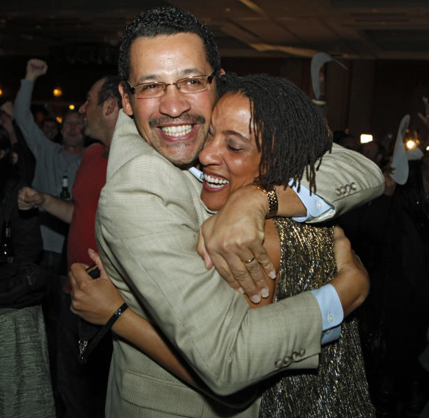 FILE - In this Nov. 6, 2012 file photo, Roland and Natalie Jones embrace as President Barack Obama is predicted as the winner over challenger Mitt Romney at a Colorado Democrat's election party at the Sheraton Hotel in Denver. As a divisive legislative session ended this month, Colorado Democrats muscled through the Statehouse a massive elections reform bill that allows voters to register up until Election Day and still cast their ballots. It's the latest _ and most substantial _ development in a nationwide Democratic Party effort to strike back at two years of Republican success in passing measures to require identification at polling places and purge rolls of suspect voter. (AP Photo/Ed Andrieski, File)
