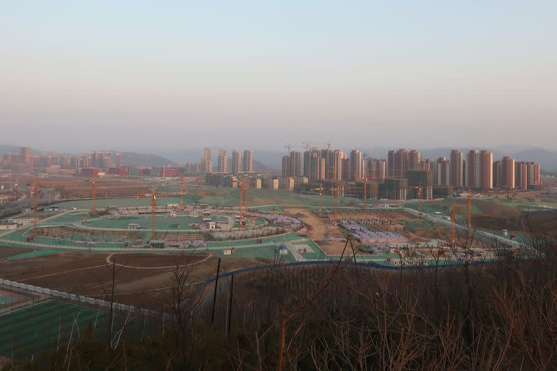 FILE PHOTO: School and residential buildings under construction are seen at Yanan New Zone