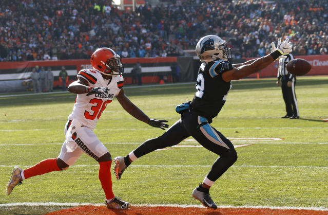 Carolina Panthers wide receiver D.J. Moore, right, reaches but can't catch the pass under pressure from Cleveland Browns defensive back T.J. Carrie during the first half of an NFL football game, Sunday, Dec. 9, 2018, in Cleveland. (AP Photo/Ron Schwane)