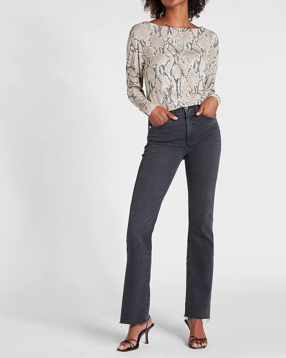 <p>This <span>Express Relaxed Printed Crew Neck Tee</span> ($48) brings drama in the most elegant way. It offers plenty of coverage, a relaxed yet put-together silhouette, and an eye-catching print. Tuck it into your favorite work pants or casual jeans.</p>