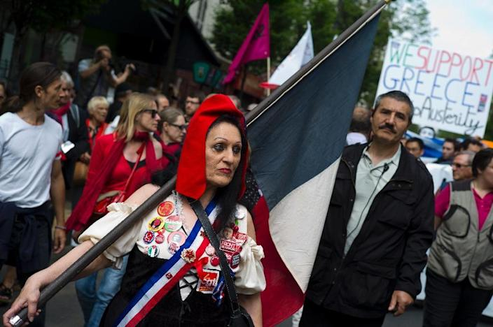 A woman dressed as a French 1789 revolutionary takes part in a demonstration in support of both migrants and the Greek people on June 20, 2015 in Paris (AFP Photo/Kenzo Tribouillard)