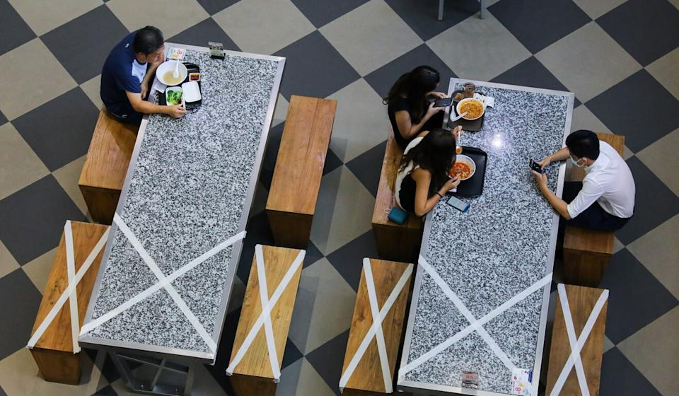 People observe social distancing at a food court in Hong Kong Photo: Dickson Lee