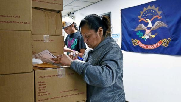 PHOTO: Sherri Two Horses fills out an absentee ballot for the 2018 mid-term election at the Sioux County Court House on the Standing Rock Reservation in Fort Yates, North Dakota, Oct. 26, 2018. (Dan Koeck/Reuters)