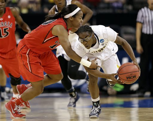 California's Eliza Pierre, right, is fouled by Georgia's Jasmine James during the second half in a regional final in the NCAA women's college basketball tournament, Monday, April 1, 2013, in Spokane, Wash. (AP Photo/Elaine Thompson)