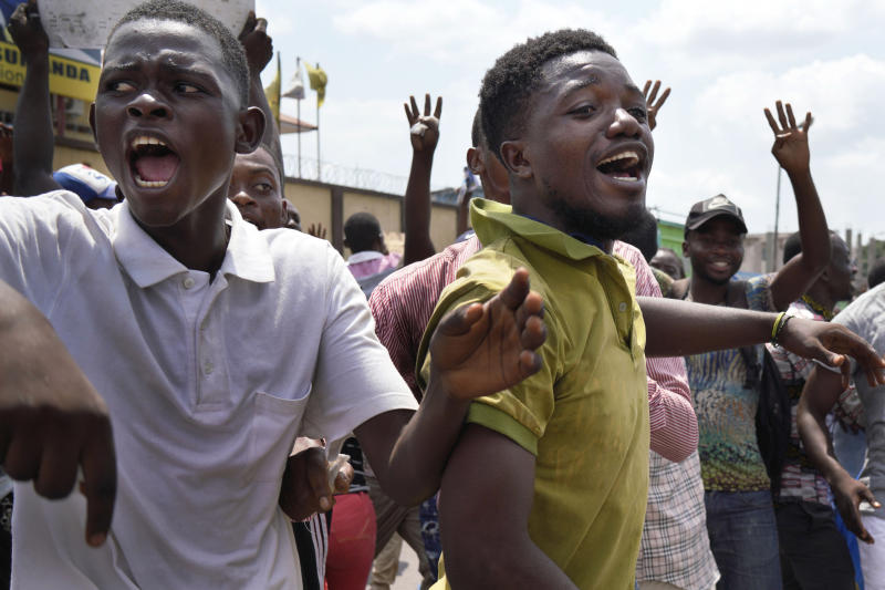 "Supporters of spurned Congo opposition candidate Martin Fayulu react at the presidential elections results just before Fayuly arrived to address them in Kinshasha, Congo, Friday, Jan. 11, 2019. Hundreds gathered to denounce what they called ""the people's stolen victory"" in the presidential election. (AP Photo/Jerome Delay)"