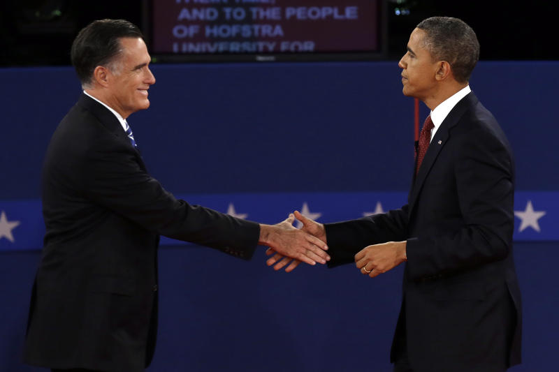 Republican presidential nominee Mitt Romney  and President Barack Obama shake hands after the second presidential debate at Hofstra University, Tuesday, Oct. 16, 2012, in Hempstead, N.Y. (AP Photo/Charlie Neibergall)
