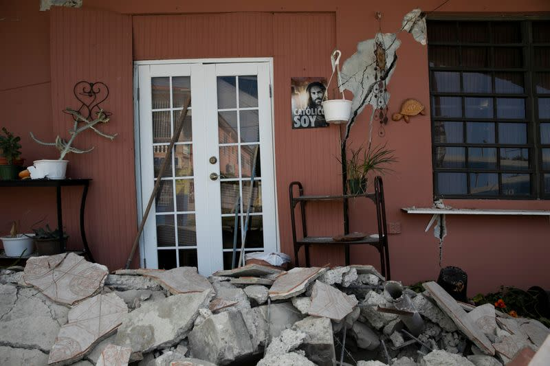 The entrance of a damaged house is seen after an earthquake in Guanica