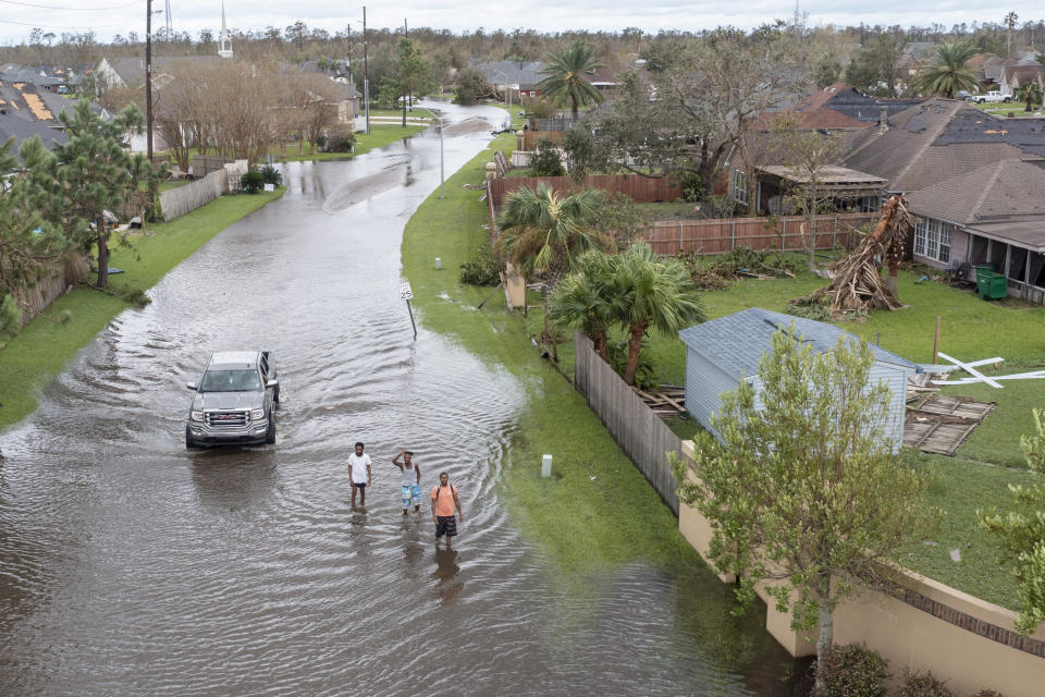Flooded streets are shown in the Spring Meadow subdivision in LaPlace, La., after Hurricane Ida moved through Monday, Aug. 30, 2021. Hard-hit LaPlace is squeezed between the Mississippi River and Lake Pontchartrain. (AP Photo/Steve Helber)