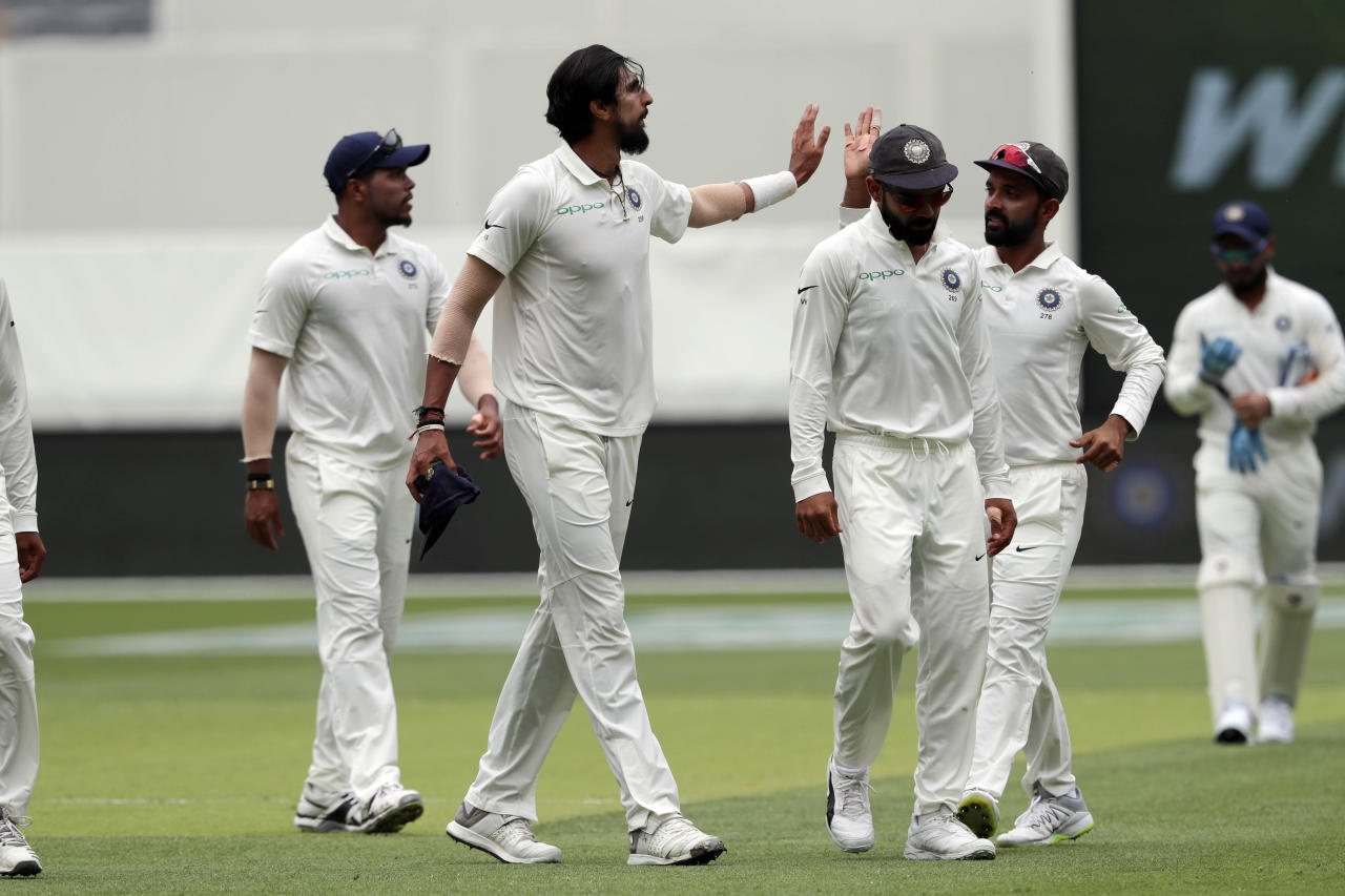 India's Ishant Sharma (2nd left) celebrates with teammates after taking the wicket of Australia's Mitchell Starc during play in the second cricket test between Australia and India in Perth, Australia, Saturday, Dec. 15, 2018. (AP Photo/Trevor Collens)