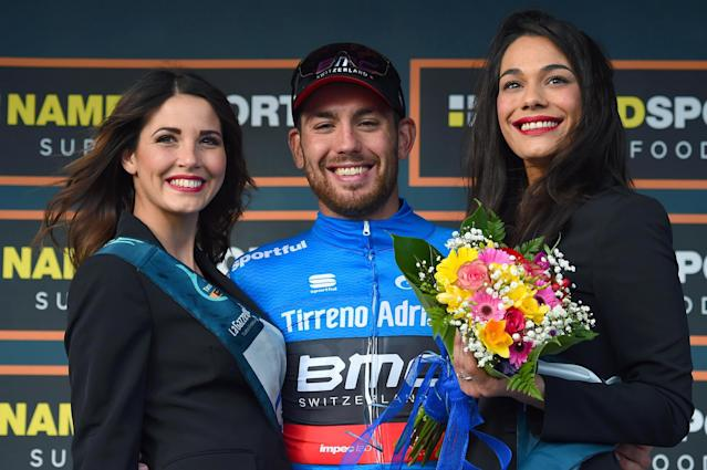 Overall leader Australia's Patrick Bevin smiles on the podium after completing the 2nd stage of the Tirreno-Adriatico cycling race, from Camaiore to Follonica, Italy, Thursday, March 8, 2018. Marcel Kittel got his first win of the season as the German rider sprinted to victory at the end of a crash-marred second stage of the Tirreno-Adriatico on Thursday, while Patrick Bevin moved into the overall lead. (Dario Belingheri/ANSA via AP)