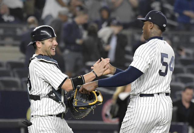 New York Yankees catcher Austin Romine, left, and pitcher Aroldis Chapman congratulate each other after the Yankees defeated the Washington Nationals 3-0 in a baseball game Tuesday, June 12, 2018, at Yankee Stadium in New York. (AP Photo/Bill Kostroun)