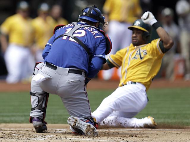 Texas Rangers catcher A.J. Pierzynski, left, waits at home plate to make the tag on Oakland Athletics' Chris Young in the second inning of a baseball game, Monday, Sept. 2, 2013, in Oakland, Calif. (AP Photo/Ben Margot)