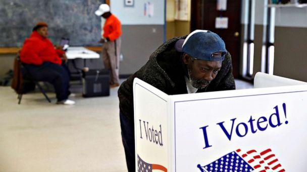 PHOTO: John Singleton fills out his ballot at a polling station for the Democratic presidential primary, in Charleston, S.C., Feb. 29, 2020. (Patrick Semansky/AP)