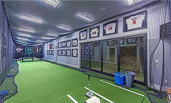 """Custom-built in 2011, the three-story home features a movie theater, wine cellar, game room and indoor batting cage across 11,000 square feet. <span class=""""copyright"""">(Realtor.com)</span>"""