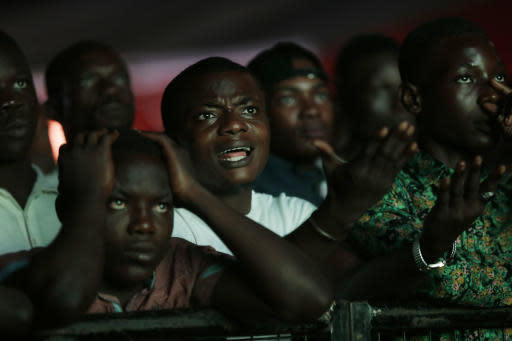 Nigeria's national soccer team fans react during a televised broadcast of the Russia 2018 World Cup match between Croatia and Nigeria, in Lagos, Nigeria, Saturday, June 16, 2018. (AP Photo/Sunday Alamba)