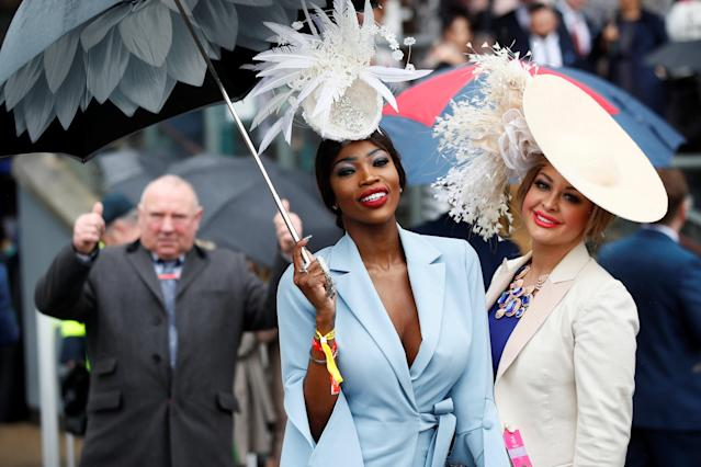 Horse Racing - Grand National Festival - Aintree Racecourse, Liverpool, Britain - April 13, 2018 Racegoers during Ladies Day at the Grand National Festival Action Images via Reuters/Jason Cairnduff