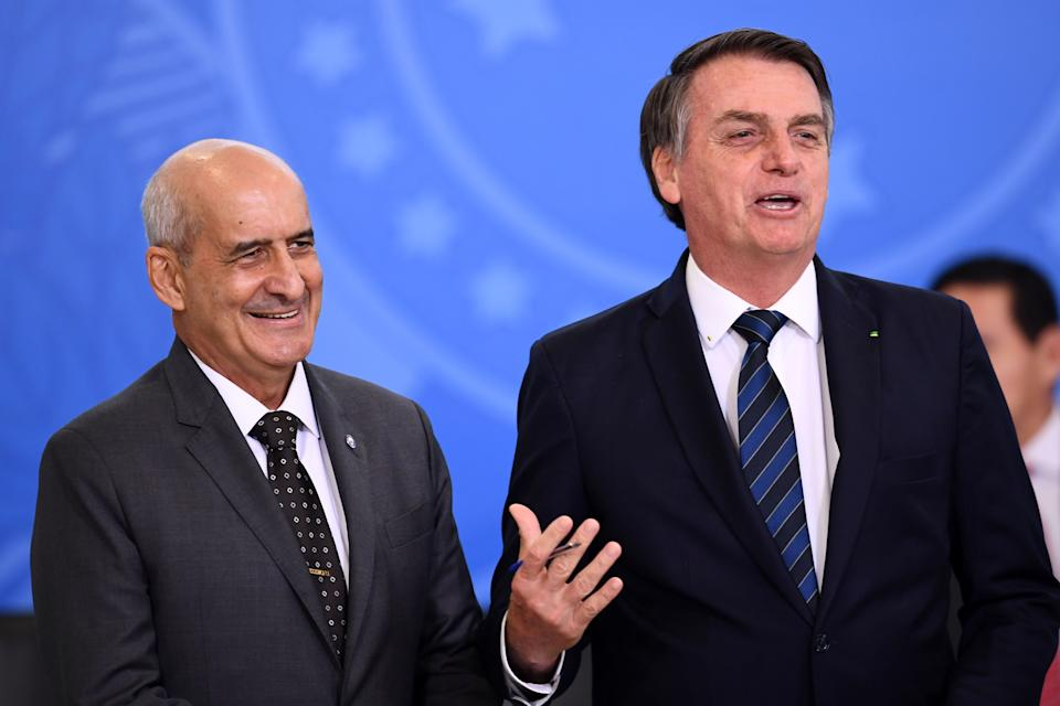 Brazilian President Jair Bolsonaro (R) speaks next to the new Head of the Secretariat of Government of the Presidency Luiz Eduardo Ramos, during his inauguration ceremony at Planalto Palace in Brasilia, on July 04, 2019. - Ramos replaces Carlos Alberto dos Santos Cruz in the Secreariat after some disagreements with of Bolsonaro's sons during his administration. (Photo by EVARISTO SA / AFP)        (Photo credit should read EVARISTO SA/AFP via Getty Images)