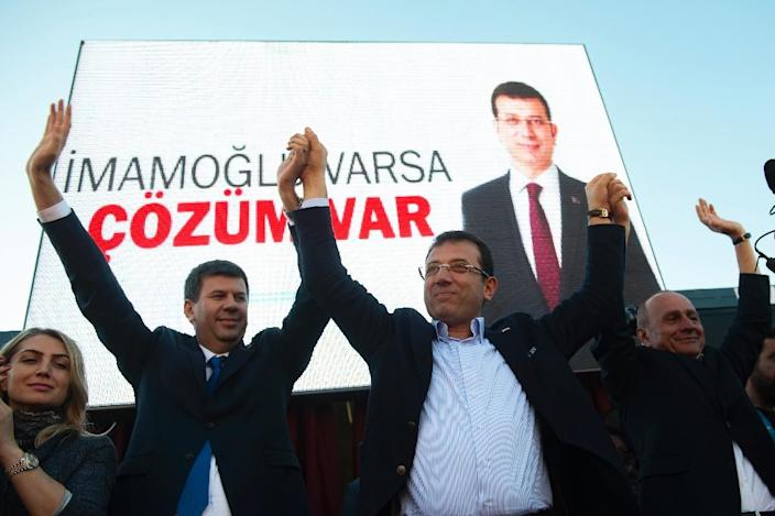 Fielding a younger candidate, Ekrem Imamoglu (C), the opposition CHP hopes a fresh approach will help them take the Istanbul mayor's office (AFP Photo/Yasin AKGUL)