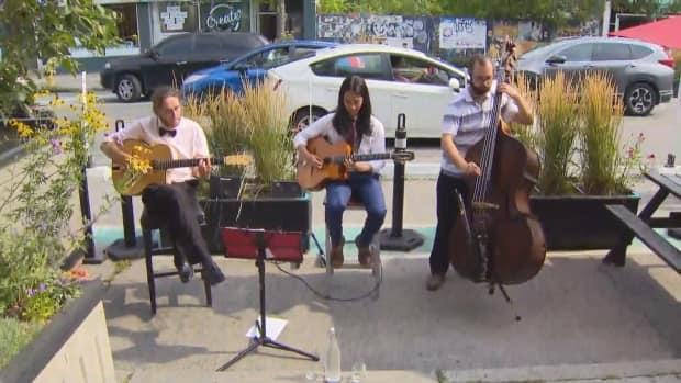 Tak Arikushi Trio is one of many music groups and musicians seeking to take advantage of the city's new pilot project announced Thursday. The Trio played shortly after Mayor John Tory's announcement at Italian restaurant Trecce's patio. (CBC - image credit)