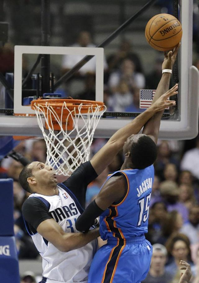 Dallas Mavericks forward Brandan Wright (34) defends on a shot by Oklahoma City Thunder guard Reggie Jackson (15) during the first half of an NBA basketball game Tuesday, March 25, 2014, in Dallas. (AP Photo/LM Otero)
