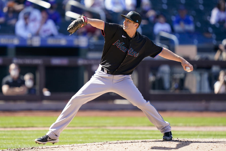 Miami Marlins relief pitcher Ross Detwiler throws during the fifth inning of a baseball game against the New York Mets, Thursday, April 8, 2021, in New York. (AP Photo/John Minchillo)