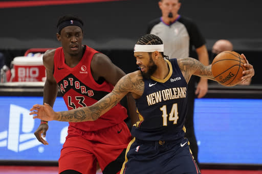 New Orleans Pelicans forward Brandon Ingram (14) works against Toronto Raptors forward Pascal Siakam (43) during the second half of an NBA basketball game Wednesday, Dec. 23, 2020, in Tampa, Fla. (AP Photo/Chris O'Meara)