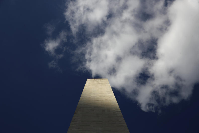 Clouds roll over the Washington Monument, as seen from the foot of the monument, during a press preview tour ahead of its official reopening, Wednesday, Sept. 18, 2019, in Washington. The monument, which has been closed to the public since August 2016, is scheduled to re-open Thursday, Sept. 19. (AP Photo/Patrick Semansky)