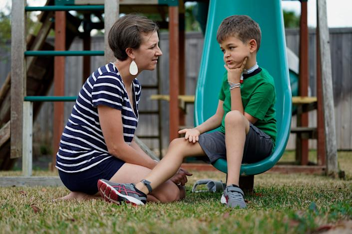 """Rachel Scott, left, talks with her son, Braden, in Tomball, Texas, on Friday, March 29, 2019. """"Everyone is desperate for some magical thing"""" to cure the kids, said Rachel. Braden developed acute flaccid myelitis, or AFM, in 2016."""