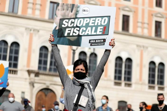 Demonstrators protest against restrictive measures put in place to fight COVID-19, in Rome