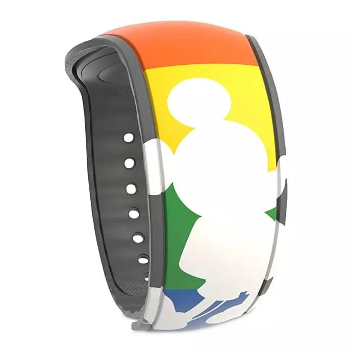 """<p>Everything at Disney is rainbows and magic with this <a href=""""https://www.popsugar.com/buy/Rainbow-Disney-Collection-Mickey-Mouse-MagicBand-2-491607?p_name=Rainbow%20Disney%20Collection%20Mickey%20Mouse%20MagicBand%202&retailer=shopdisney.com&pid=491607&price=25&evar1=savvy%3Aus&evar9=46629568&evar98=https%3A%2F%2Fwww.popsugar.com%2Fhome%2Fphoto-gallery%2F46629568%2Fimage%2F46629570%2FRainbow-Disney-Collection-Mickey-Mouse-MagicBand-2&list1=disney%2Cwalt%20disney%20world&prop13=api&pdata=1"""" rel=""""nofollow"""" data-shoppable-link=""""1"""" target=""""_blank"""" style=""""background-color: rgb(255, 255, 255);"""" class=""""ga-track"""" data-ga-category=""""Related"""" data-ga-label=""""http://www.shopdisney.com/rainbow-disney-collection-mickey-mouse-magicband-2-400021267879.html"""" data-ga-action=""""In-Line Links"""">Rainbow Disney Collection Mickey Mouse MagicBand 2</a> ($25).</p>"""