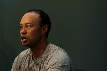 """Golfer Tiger Woods speaks as he sits down to sign copies of his new book """"The 1997 Masters: My Story"""" at a book signing event at a Barnes & Noble store in New York"""