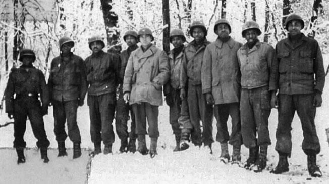 Men of C Battery, 333rd, pose for a photo with Captain William G. McLeod, center, in a wintry landscape about the time the massacre occurred. McLeod greatly respected his men and the feeling was mutual.