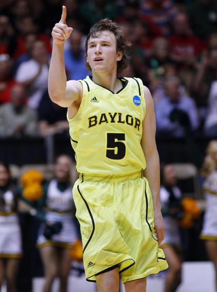Baylor guard Brady Heslip (5) gestures after hitting a three-point basket against Colorado during the first half of an NCAA tournament third-round college basketball game on Saturday, March 17, 2012, in Albuquerque, N.M. (AP Photo/Matt York)