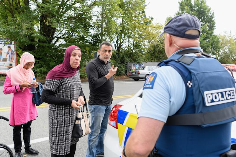 People concerned about the fate of their relatives talk to police outside the Al Noor mosque in Christchurch, New Zealand, on March 15, 2019. (Kai Schwoerer via Getty Images)