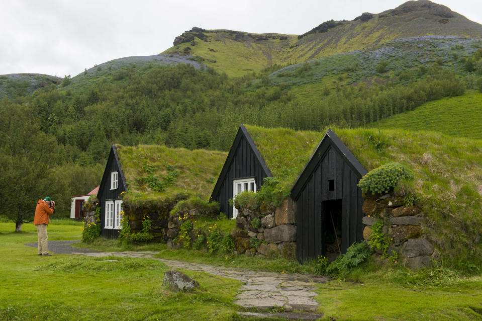 ICELAND – 2017/06/30: Tourist photographing traditional turf houses at the Skogar folk museum in southern Iceland. (Photo by Wolfgang Kaehler/LightRocket via Getty Images)