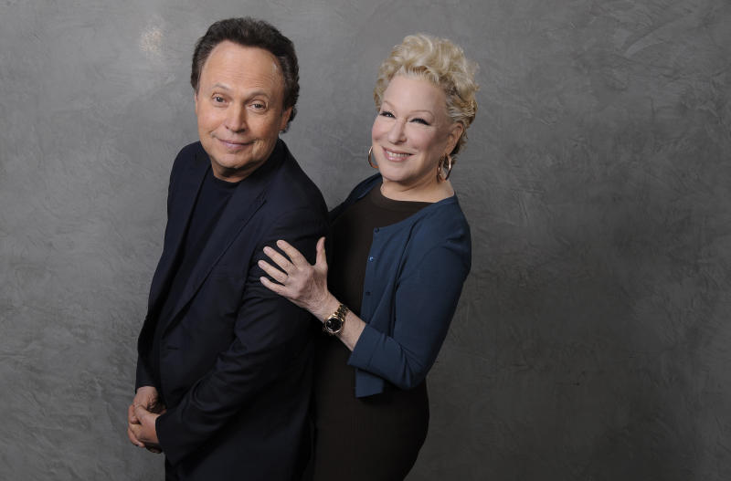 """In this Saturday, Dec. 15, 2012 photo, Billy Crystal, left, and Bette Midler, cast members in the film """"Parental Guidance,"""" pose together for a portrait at the Ritz Carlton Hotel in Los Angeles. Longtime friends Crystal and Midler finally share the screen in """"Parental Guidance,"""" in theaters Christmas Day. (Photo by Chris Pizzello/Invision/AP)"""