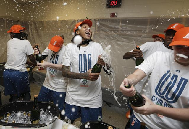 Minnesota Lynx' Seimone Augustus, center, celebrates after defeating the Atlanta Dream 86-77 in Game 3 of the WNBA Finals basketball game in Duluth, Ga., Thursday, Oct. 10, 2013. (AP Photo/John Bazemore)