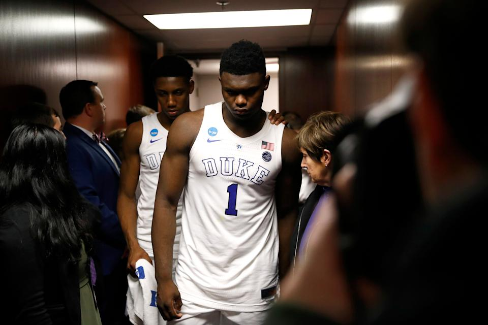 Duke forward Zion Williamson (1) walks out of the Duke locker room with teammate Tre Jones after a loss to Michigan State. (AP)