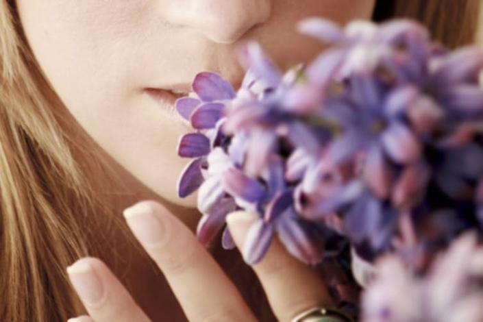 """<span class=""""caption"""">Some people lose their sense of smell.</span> <span class=""""attribution""""><a class=""""link rapid-noclick-resp"""" href=""""https://www.shutterstock.com/image-photo/close-part-girl-smelling-flowers-527377111"""" rel=""""nofollow noopener"""" target=""""_blank"""" data-ylk=""""slk:Elipetit/Shutterstock"""">Elipetit/Shutterstock</a></span>"""
