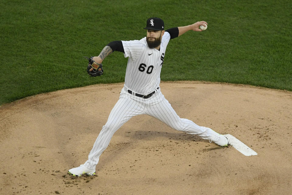 Chicago White Sox starter Dallas Keuchel delivers a pitch during the first inning of a baseball game against the Cleveland Indians, Monday, April 12, 2021, in Chicago. (AP Photo/Paul Beaty)