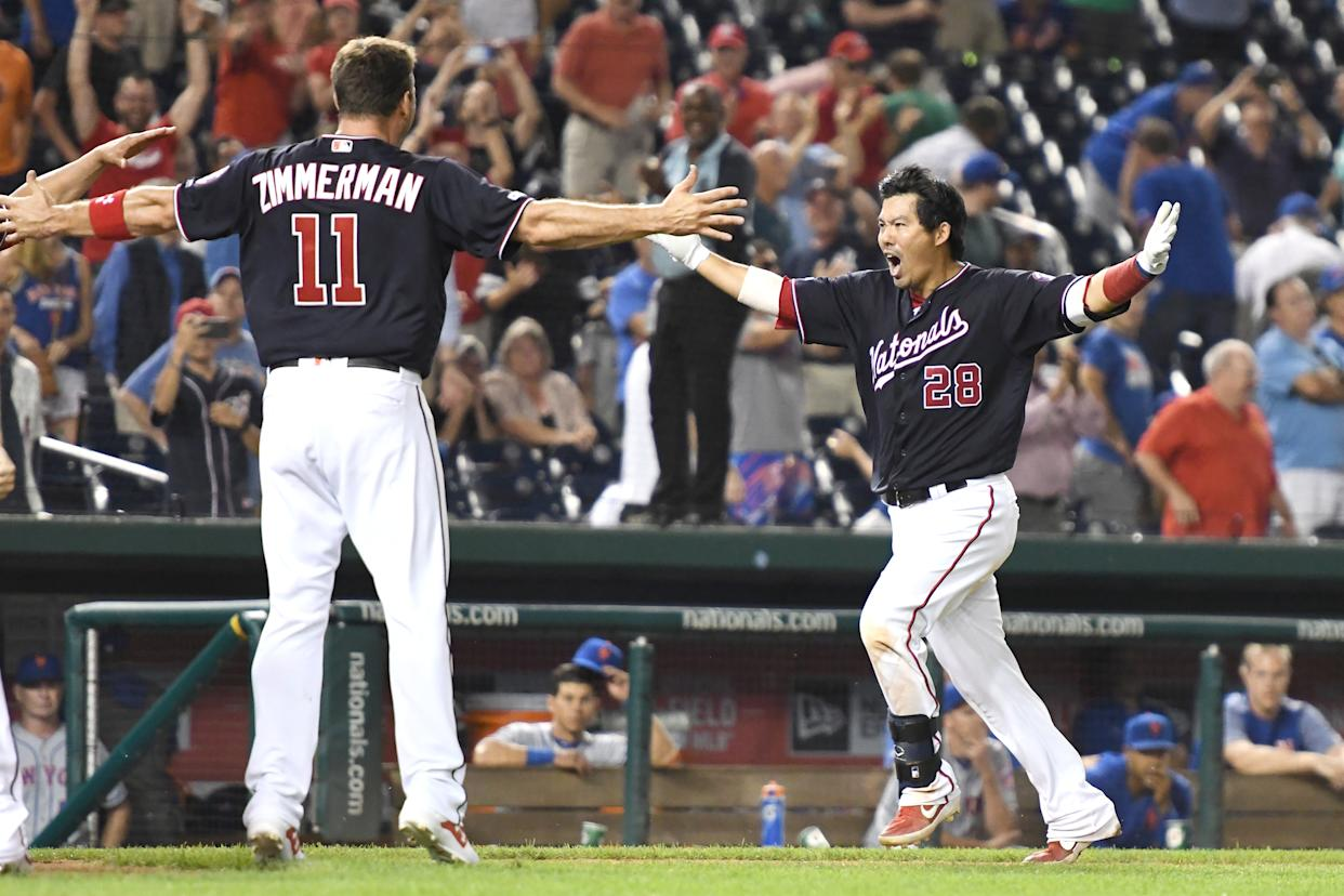 Kurt Suzuki #28 of the Washington Nationals celebrates a walk off home run in the ninth inning with Ryan Zimmerman #11 during a baseball game against the New York Mets at Nationals Park on September 3, 2019 in Washington, DC. (Photo by Mitchell Layton/Getty Images)