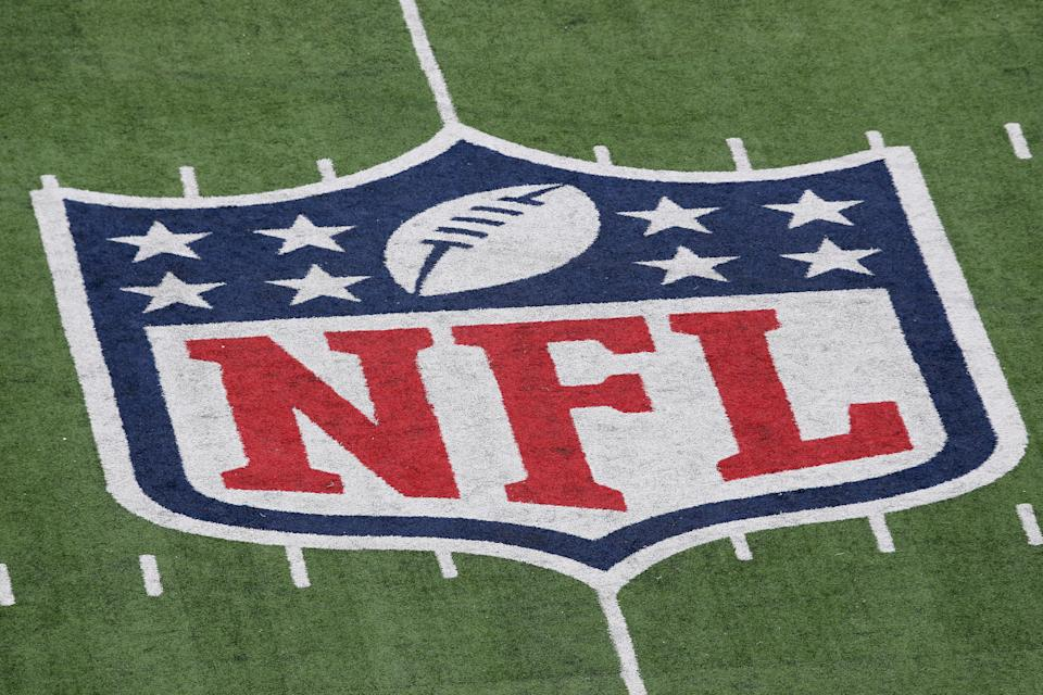 A detail of the official National Football League NFL logo is seen painted on the turf as the New York Giants host the Atlanta Falcons during their NFC Wild Card Playoff game at MetLife Stadium on January 8, 2012 in East Rutherford, New Jersey.  (Photo by Nick Laham/Getty Images)