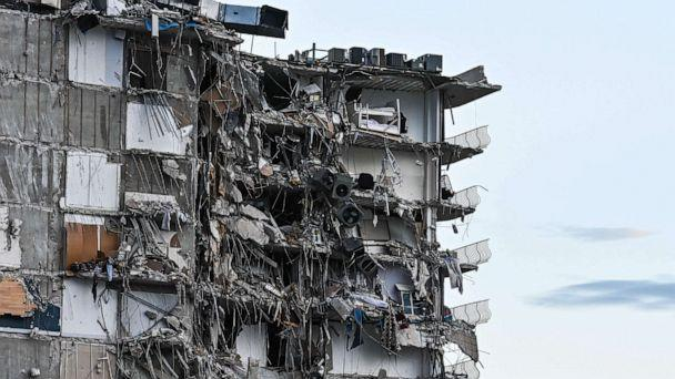PHOTO: Rubble hangs from a partially collapsed building in Surfside, Fla., north of Miami Beach, on June 24, 2021. (Chandan Khanna/AFP via Getty Images)