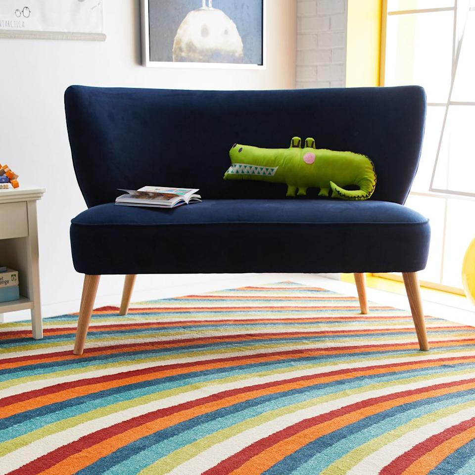 "<p>If your goal is to ""save money and live better,"" then head straight to Walmart. Believe it or not, the major retailer has a growing range of rugs to fit any room, style, or budget. Drew Barrymore Flower Home has standout options for anyone looking to add more color into their home, including this 70s-inspired rainbow beauty.</p><p><a class=""body-btn-link"" href=""https://go.redirectingat.com?id=74968X1596630&url=https%3A%2F%2Fwww.walmart.com%2Fip%2FRainbow-Area-Rug-by-Drew-Barrymore-Flower-Kids%2F529413741&sref=http%3A%2F%2Fwww.goodhousekeeping.com%2Fhome%2Fdecorating-ideas%2Fg30858332%2Fbest-places-to-buy-rugs%2F"" target=""_blank"">SHOP NOW</a></p>"