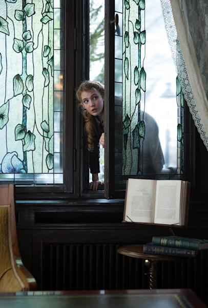 "This image released by 20th Century Fox shows Sophie Nélisse in a scene from ""The Book Thief,"" about a girl who loves books. (AP Photo/20th Century Fox, Jules Heath)"